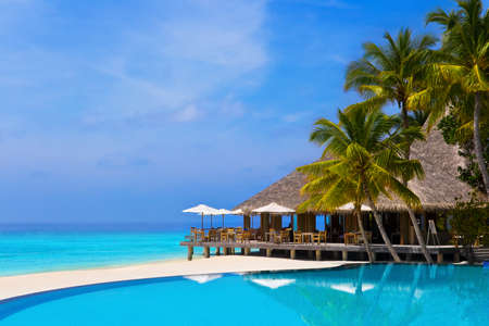 Photo pour Cafe and pool on a tropical beach - travel background - image libre de droit