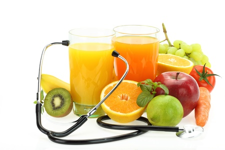 Foto de Healthy eating. Fruits, vegetables, juice and stethoscope - Imagen libre de derechos