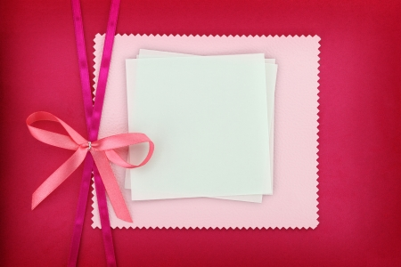 Photo for Empty card on pink fabric texture - Royalty Free Image