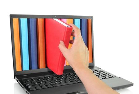 Photo pour Laptop computer with colored books  - image libre de droit