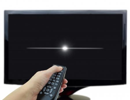 Photo pour 3D black tv display with hand and remote control - image libre de droit