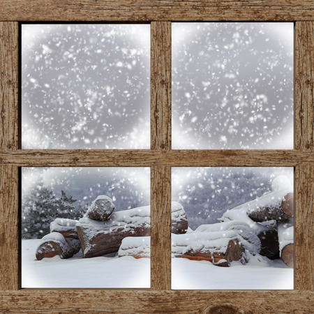 Photo for Winter outdoors view with firewood pile from wooden window - Royalty Free Image