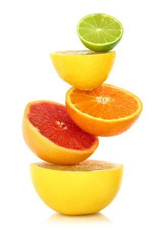 Photo pour Fresh citrus fruit in a row on white background  - image libre de droit