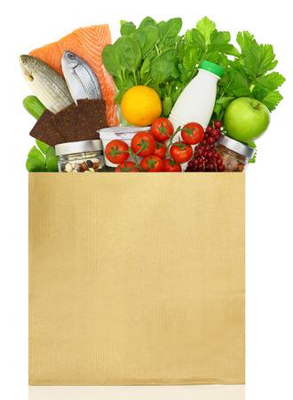 Photo pour Paper bag filled with groceries - image libre de droit