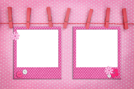 Photo for Pink photo frames hanging on a rope - Royalty Free Image