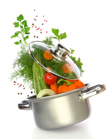 Fresh vegetables coming out of a cooking pot