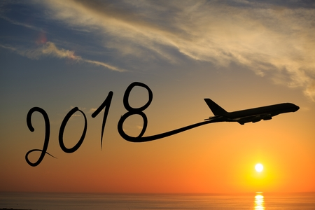 Photo pour New year 2018 drawing by airplane on the air at sunset - image libre de droit