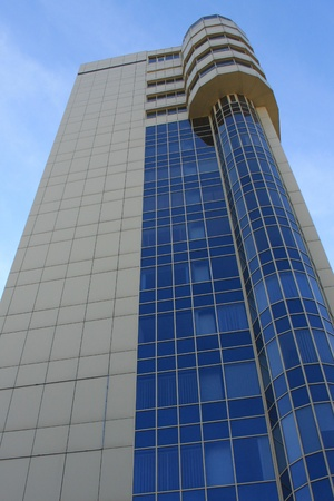 A new modern high rise building against the blue sky