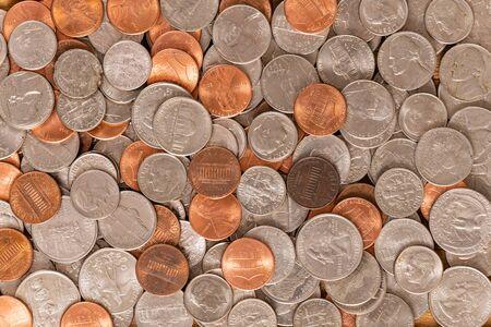 Photo pour Large pile of various United States coins closeup background. - image libre de droit