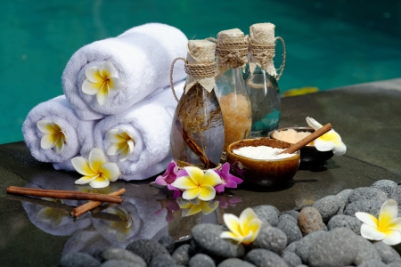 Photo for At the Spa, concept in a luxury Villa on Bali Island with, Massage oil, bath-salt, Volcanic stones, body scrub, Towels,Cinnamon sticks, Orchids and flowers   - Royalty Free Image