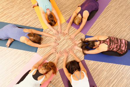 Foto de Hands of the women forming circle at Yoga class - Imagen libre de derechos