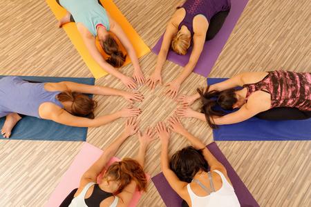 Foto de Hands of the women forming circle at Yoga class - Imagen libre de derechos