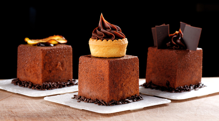 Photo for Fine dining, French dark chocolate gourmet mignon cakes - Royalty Free Image