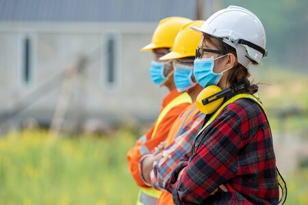 Foto für Group of Asian engineers wearing protective mask to Protect Against Covid-19 with helmet safety in the construction site,Coronavirus has turned into a global emergency,Safety concept. - Lizenzfreies Bild