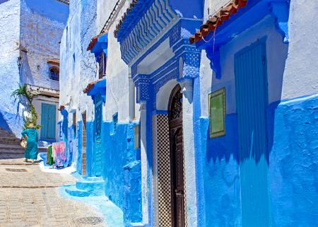 Foto de Street and building at Chefchaouen, the blue city in the Morocco. Old traditional town. Travel destination concept. Architectural decoration and design details. - Imagen libre de derechos