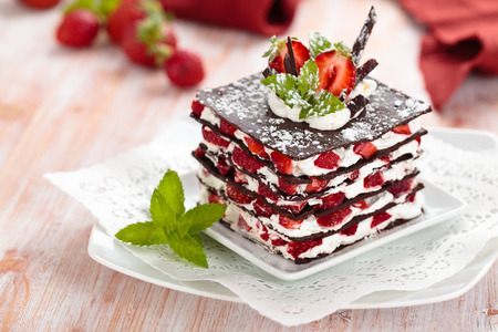 Photo for Chocolate dessert with strawberries, whipped cream and mint. - Royalty Free Image