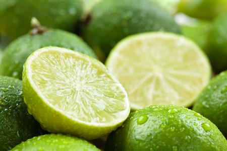 Photo pour Backgrounds. Close up shot ofwet  limes. Focus on the central part of sliced lime. - image libre de droit