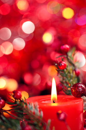 Photo pour Christmas decoration with candle against red holiday lights. - image libre de droit