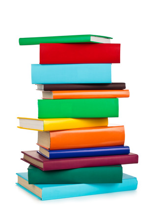 Foto de Stack of colorful books. Isolated on white background. - Imagen libre de derechos