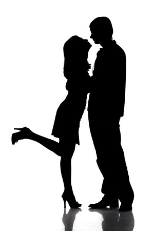 Photo for Silhouette of kissing happy couple - Royalty Free Image
