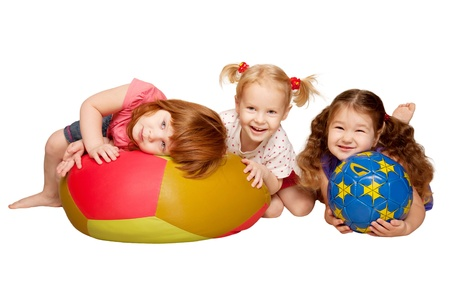 Group of kids lying and playing with balls  Isolated on white background
