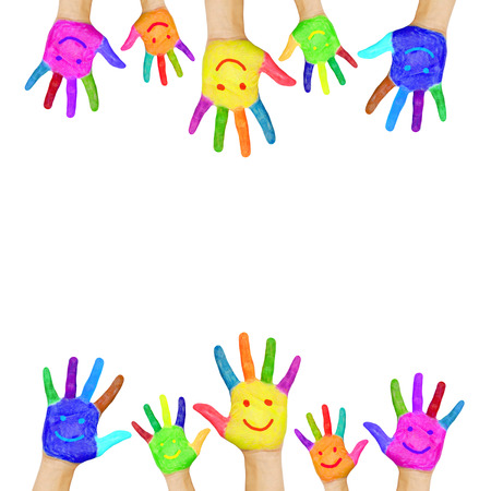 Foto de Frame of colorful hands painted with smiling faces  Fun, joy, happiness and good cheer  Baby, child and adult hands  Joyful party or celebration  Isolated on white background - Imagen libre de derechos