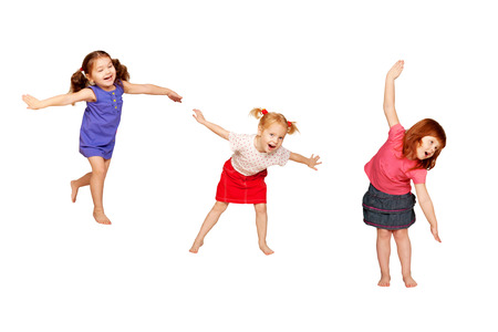 Foto de Happy dancing kids. Isolated on white background. - Imagen libre de derechos