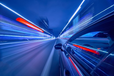 Foto per View from Side of Car moving in a night city, Blured road with lights with car on high speed. Concept rapid rhythm of a modern city. - Immagine Royalty Free