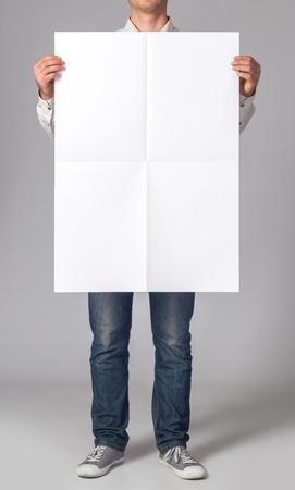 Photo pour Man holding a blank poster - image libre de droit