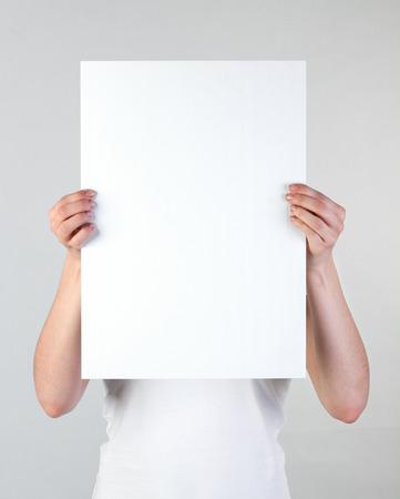 Photo pour Woman holding a blank poster - image libre de droit