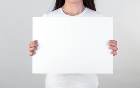 Photo for Woman holding a blank poster - Royalty Free Image