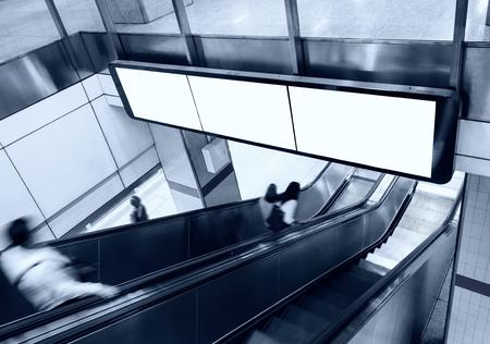 Foto de Blank Banner Billboard Display with escalator and people in subway station - Imagen libre de derechos