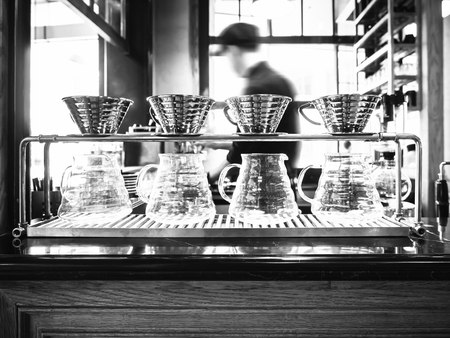Foto de Drip coffee with blurred Barista background restaurant cafe - Imagen libre de derechos