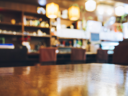 Foto de Blurred Restaurant table counter Bar shop background - Imagen libre de derechos