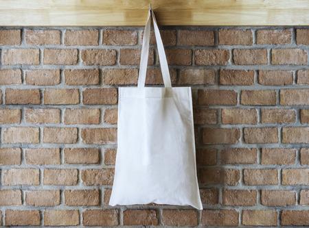 Foto de Mock up Cotton Tote Bag on Brick wall Background - Imagen libre de derechos