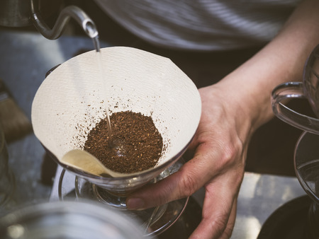 Photo pour Hand drip coffee Barista pouring water on coffee ground with filter - image libre de droit