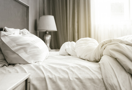 Foto de Bed sheet mattress and pillows messed up Bedroom interior - Imagen libre de derechos