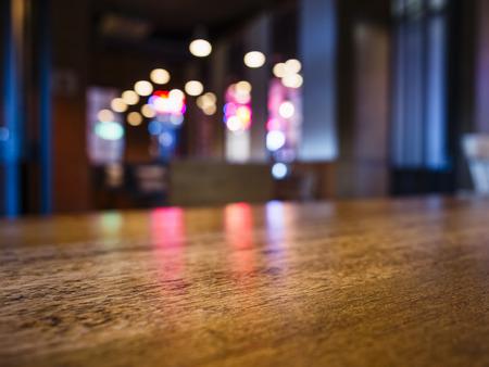 Photo pour Table top Bar counter desk Blurred colourful lighting background Party event - image libre de droit
