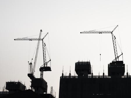 Foto de Silhouette Crane equipment Building Industrial concept - Imagen libre de derechos