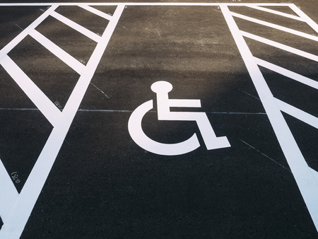 Foto per Disability wheelchair sign Priority Car park outdoor Parking lot - Immagine Royalty Free