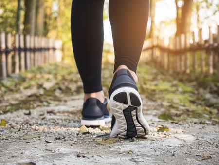 Photo pour Woman legs Hiking Trail Outdoor Lifestyle Travel adventure - image libre de droit