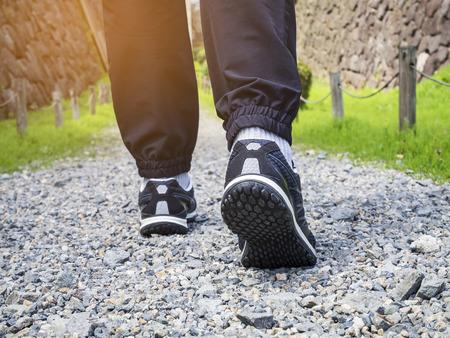 Photo pour Trail walking Man legs with sport shoe Forest Park outdoor  - image libre de droit