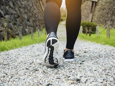 Photo pour Trail walking woman legs with sport shoe Forest Park outdoor Travel adventure  - image libre de droit