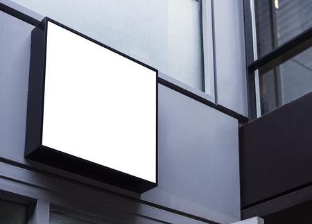 Photo pour Mock up sign black frame Shop front display building exterior - image libre de droit
