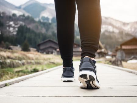 Photo pour Woman with sport shoe Traveler with Mountain landscape Outdoor Nature Lifestyle Travel adventure - image libre de droit