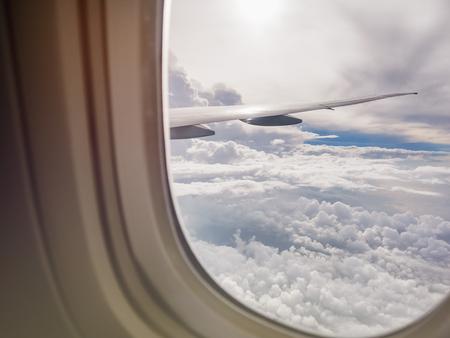 Photo pour Airplane window view cloud sky aircraft wing - image libre de droit