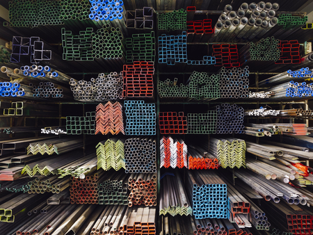 Photo pour Steel Pipes Industry Construction stacked in warehouse - image libre de droit