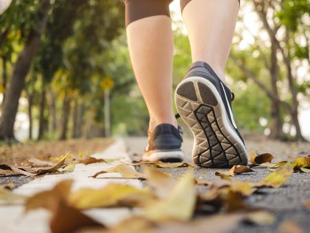 Photo pour Woman walk in park outdoor Trail exercise healthy lifestyle - image libre de droit