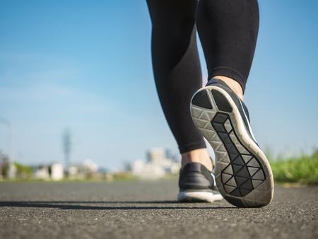 Photo pour Woman walk in park outdoor morning exercise healthy lifestyle - image libre de droit
