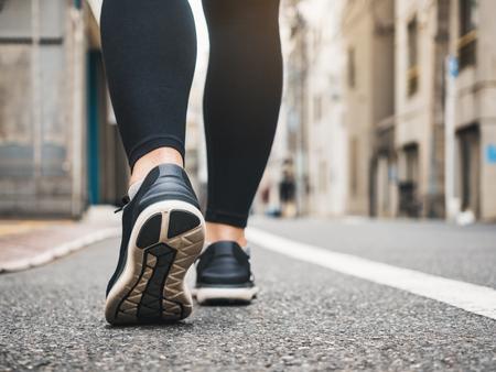 Photo pour Woman walking morning exercise in city Healthy lifestyle - image libre de droit